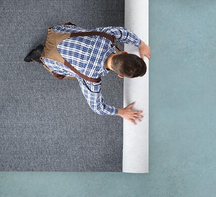 Carpet rolling for installation | Signature Flooring, Inc